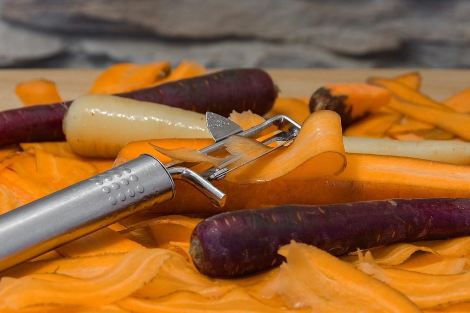Peeling carrots in the kitchen